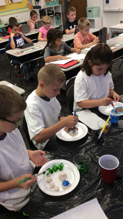 Students carefully painted their salt dough landforms.