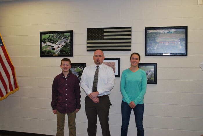 November and December Students of the Month Anna Bruno and Zack Sulzberger with Prinicipal Severson