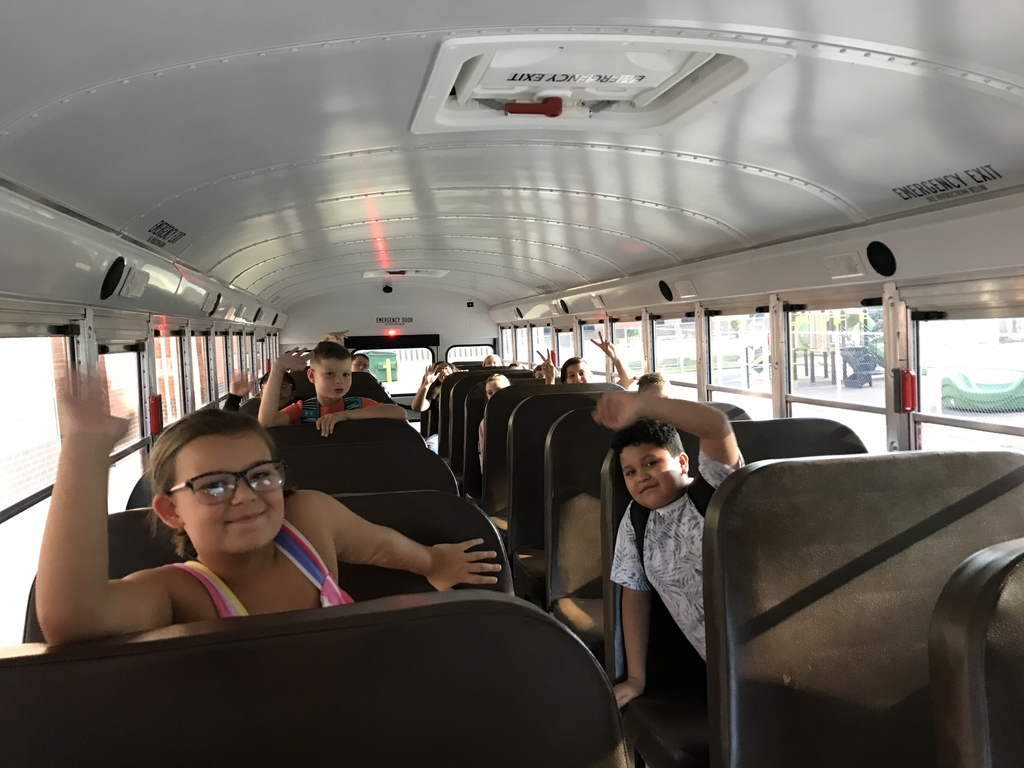This is an image of students on a school bus.